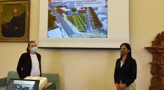 Le assessore Tonelli e Brunori con il rendering del vivaio urbano