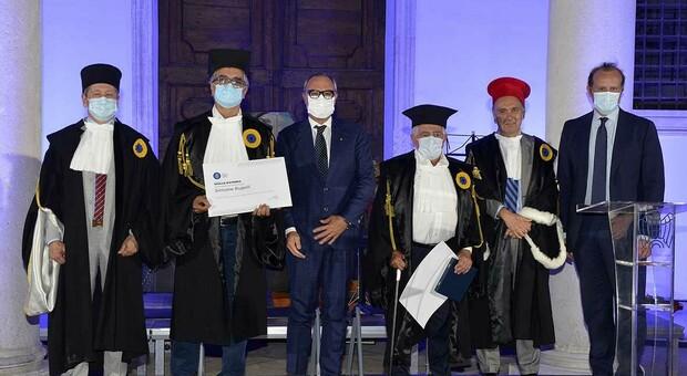 Simone Rupoli e Giancarlo Selci con, tra gi altri, il rettore dell'università Bo Calcagnini e il presidente di Confindustria Papalini